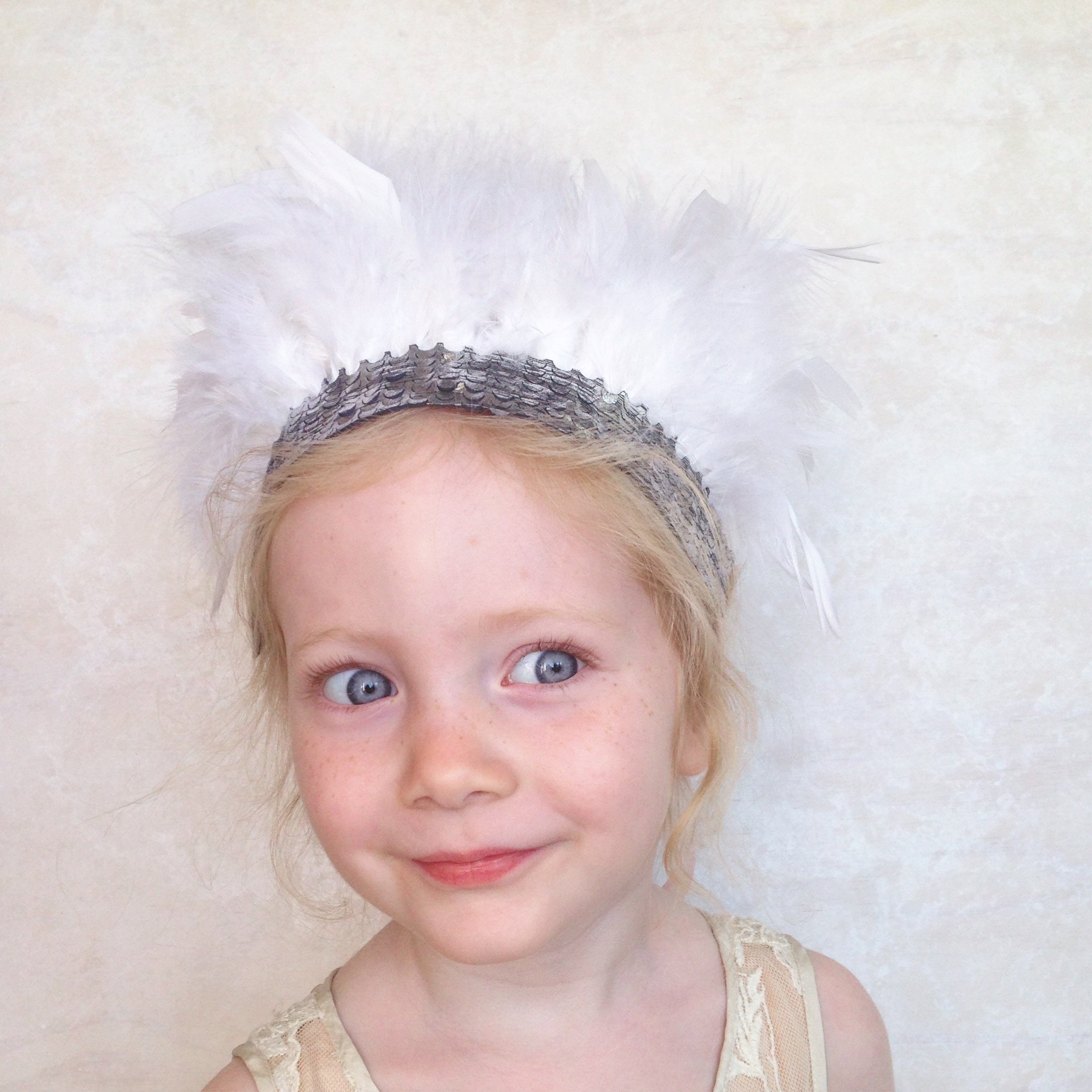 girls white feather crown headdress